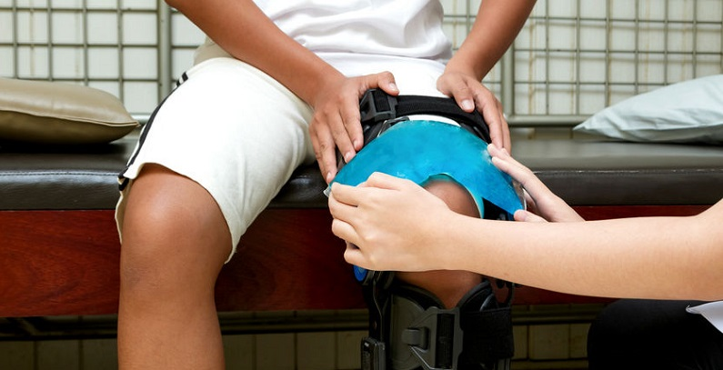 Man Receiving Physical Therapy Following Personal Injury