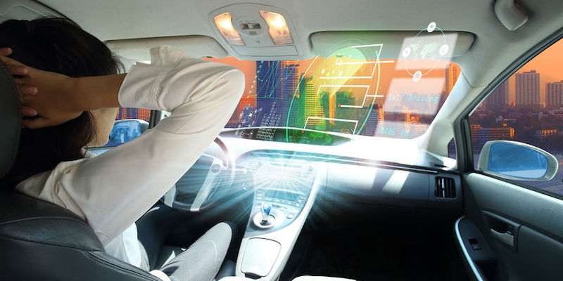 Electric car or intelligent car. Futuristic vehicle and graphical user interface, self-driving mode, autonomous car, vehicle running itself with a woman driver.